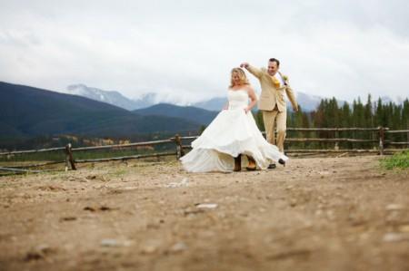 05-bride-groom-twirling-dirt-road-mountains-450x299